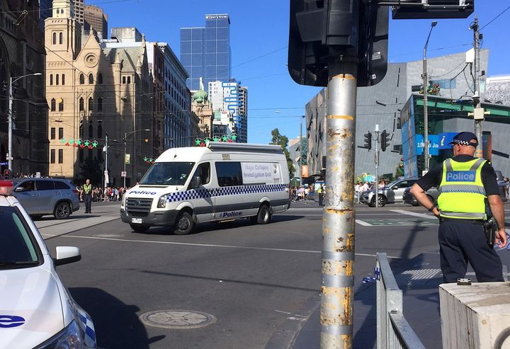 A vehicle plowed into pedestrians at a crowded intersection near the Flinders Street train station in Melbourne, Australia on