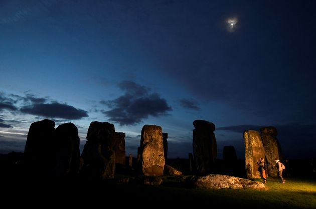 The Stonehenge monument at dawn on winter solstice, on 21 December