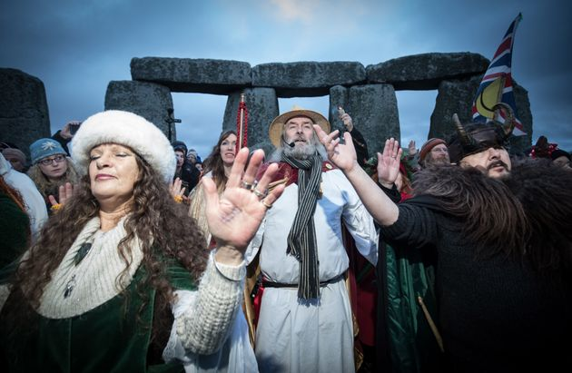 Druids, pagans and revellers gather in Stonehenge at the winter solstice ceremony in