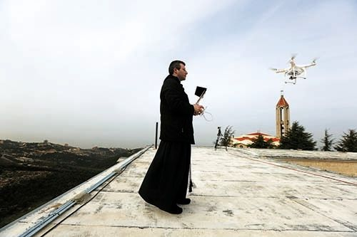 <em>A Maronite priest flies a drone to film and photograph processions and prayers at the Saint Maroun Monastery of Annaya, n
