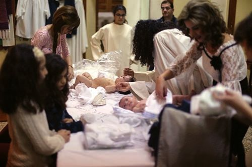 <em>Mothers prepare their babies during a baptism at a Maronite church in Beirut (courtesy Patrick Baz)</em>
