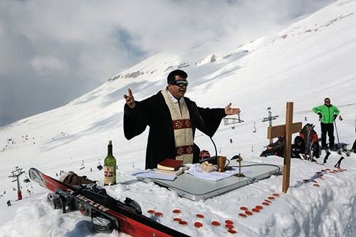 <em>Maronite Father Hani Taouk leads a mass on the ski slopes of the Cedars Mountains (courtesy AFP)</em>
