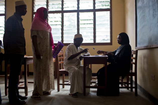 Older people collecting their pension in Zanzibar, where a universal social pension was introduced in