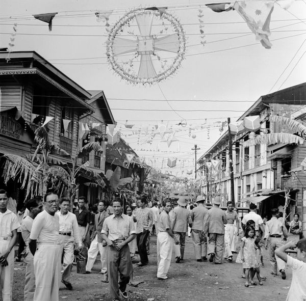 Traditional Philippino Christmas decorations hanging over the streets in the 1950s.