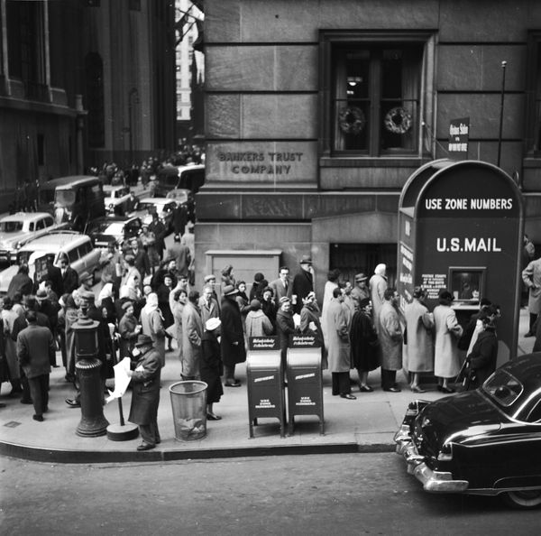 People lined up onWall Street in New York City to post their Christmas cards and packages at a huge mailbox.