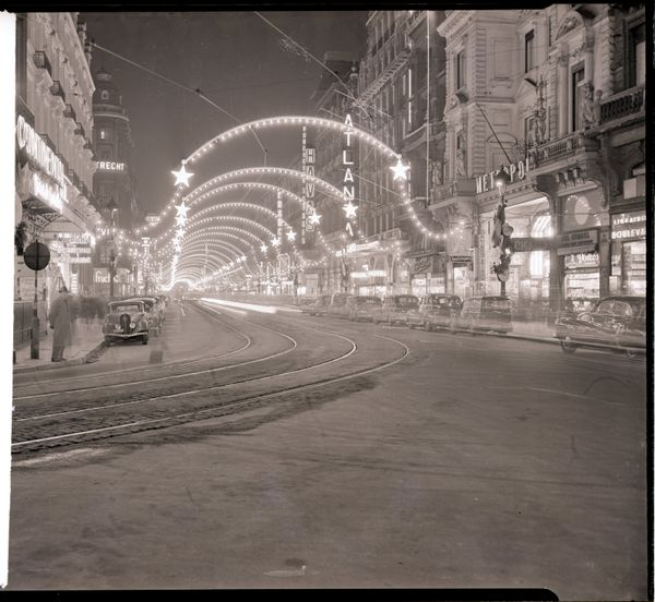 Brussels prepares for its 1949 Christmas display, with millions of colored bulbs decorating the main streets.