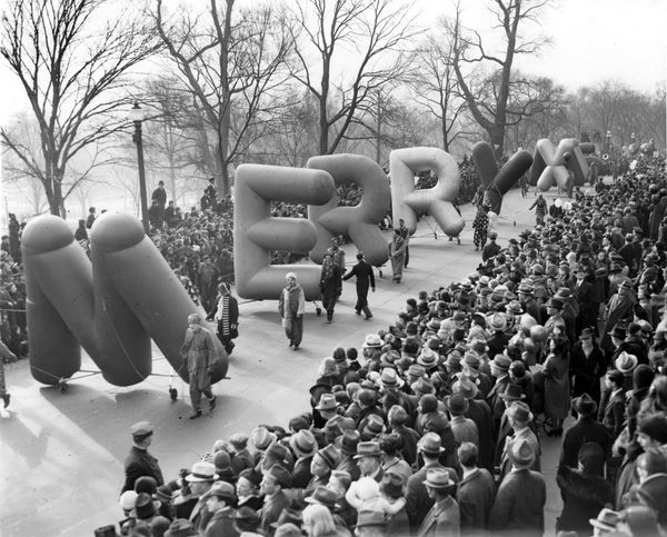 "Balloons spelling out ""Merry Xmas"" during a 1939 parade in Boston."