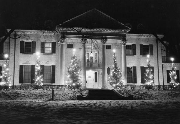 The home of Chicago Tribune publisher Robert R. McCormick in Wheaton, Illinois. There is snow on the ground and lights in the