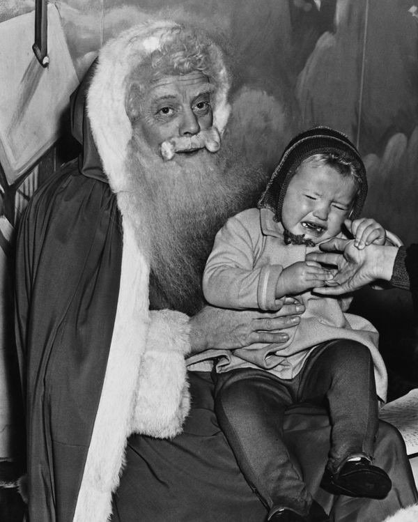 Jennifer Martin, age 2, was in tears during a visit with Santa at Harrods department store in London on Dec. 10, 1949.