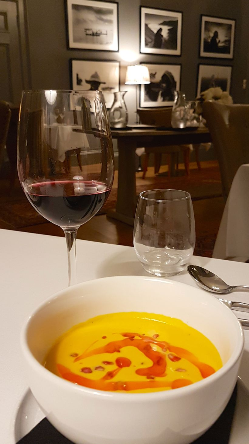A glass of malbec and wintery bowl of butternut squash velouté, served by Kendal Heraty—one of the wonderful staff who call G