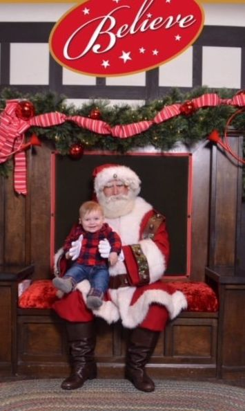 "Jessica Ziparo sent in this photo of her son Zane.<br><br>""Santa had never held a child before ... note the hands and frown,"""