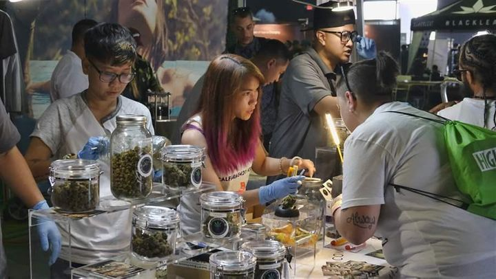 A medical marijuana provider helps attendees at the High Times Cannabis Cup in San Bernardino, California. Last month Califor