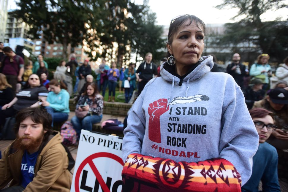 "Millie Wahl stands in Portland, Oregon, in solidarity with the ""Native Nations Rise"" march on Washington, D.C., against the c"