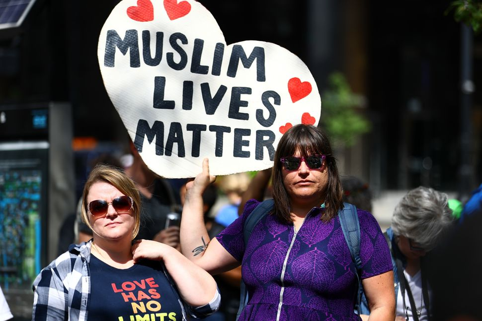 "A woman holds a banner reading ""Muslim Lives Matter"" during a protest against racism and hate in Chicago on Aug. 27, 2017."