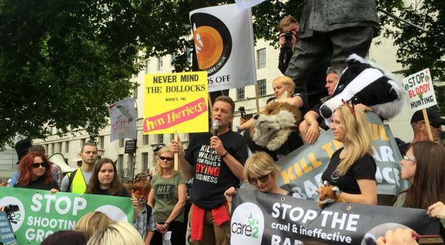 Chris Packham speaks to campaigners protesting against the killing of animals for sport after they marched...