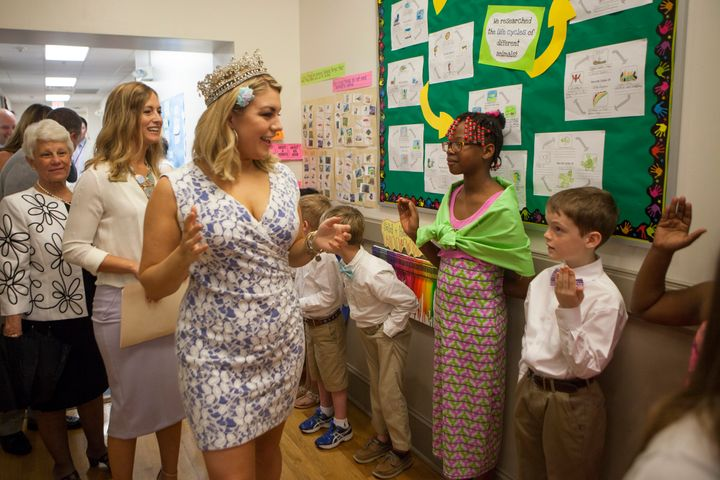 Hagan meets children at a school in 2015.