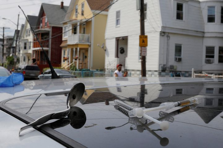 Syringes and a spoon sit on the roof of a car, where a man in his 20s overdse on opioids in Lynn, Massachusetts. U.S. life ex