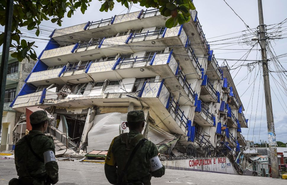 Soldiers stand guard near the Sensacion hotel, which collapsed when a powerful earthquake struck Mexico on Sept. 8,