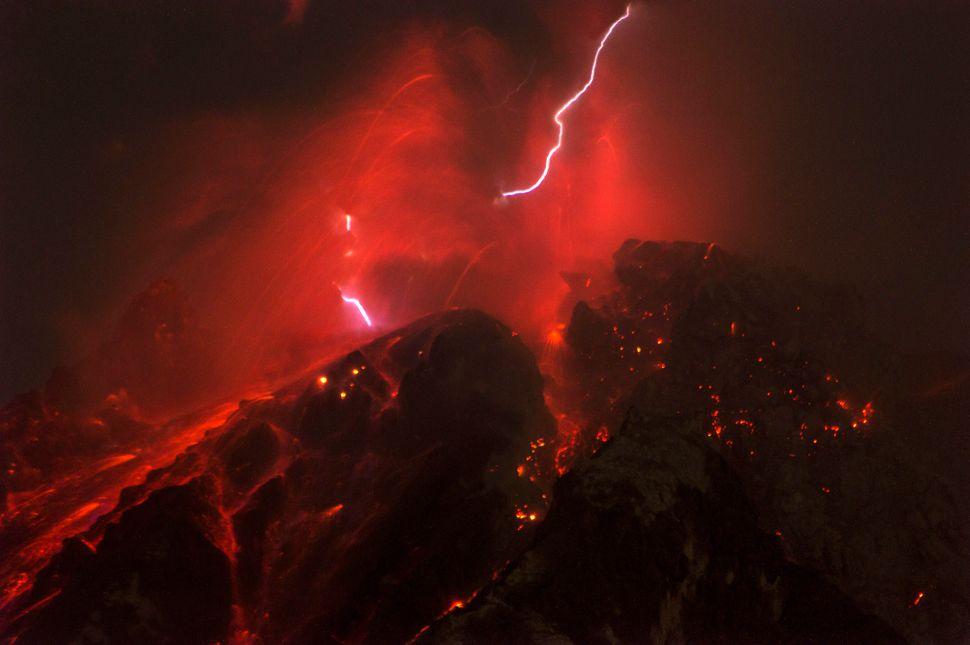 The Sinabung volcano spews molten lava duringan eruption inIndonesia onOct.14, 2017.