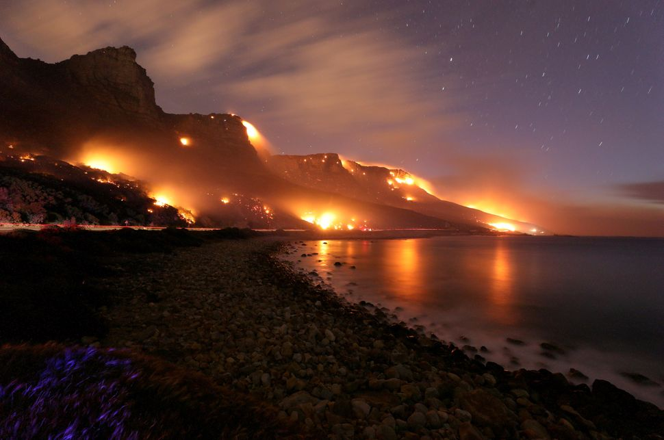 Wildfires burn along the Twelve Apostles area of Table Mountain in Cape Town, South Africa,on Oct. 13, 2017.