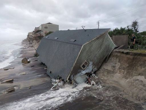 A firefighter views a collapsed coastal house after Hurricane Irma passed the area in Vilano Beach, Florida, on Sept.11