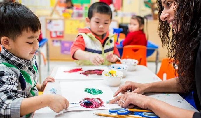 Children in the City's free Pre-K classes learn about colors while painting.