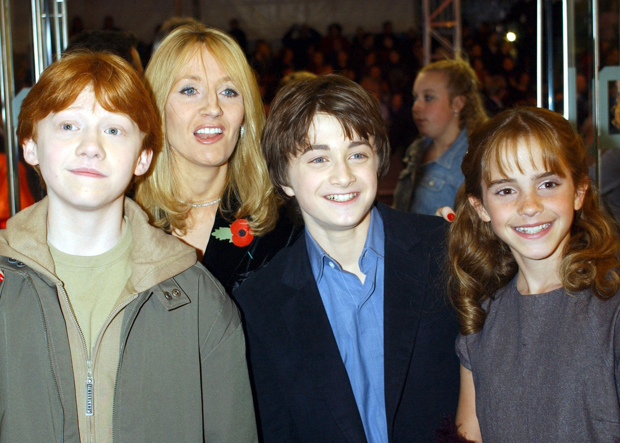 Rupert Grint, Daniel Radcliffe, and Emma Watson with the author J K Rowling.