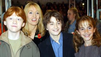The stars from left to right; Rupert Grint, Daniel Radcliffe and Emma Watson with the author J K Rowling arrive for world premiere of 'Harry Potter and the Philosopher's Stone at the Odeon Leicester Square in London.   (Photo by William Conran - PA Images/PA Images via Getty Images)