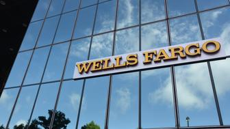 Wells Fargo & Co. signage is displayed on the exterior of a bank branch in Dallas, Texas, U.S., on Monday, July 10, 2017. Wells Fargo & Co. is scheduled to release earnings figures on July 14. Photographer: Cooper Neill/Bloomberg via Getty Images