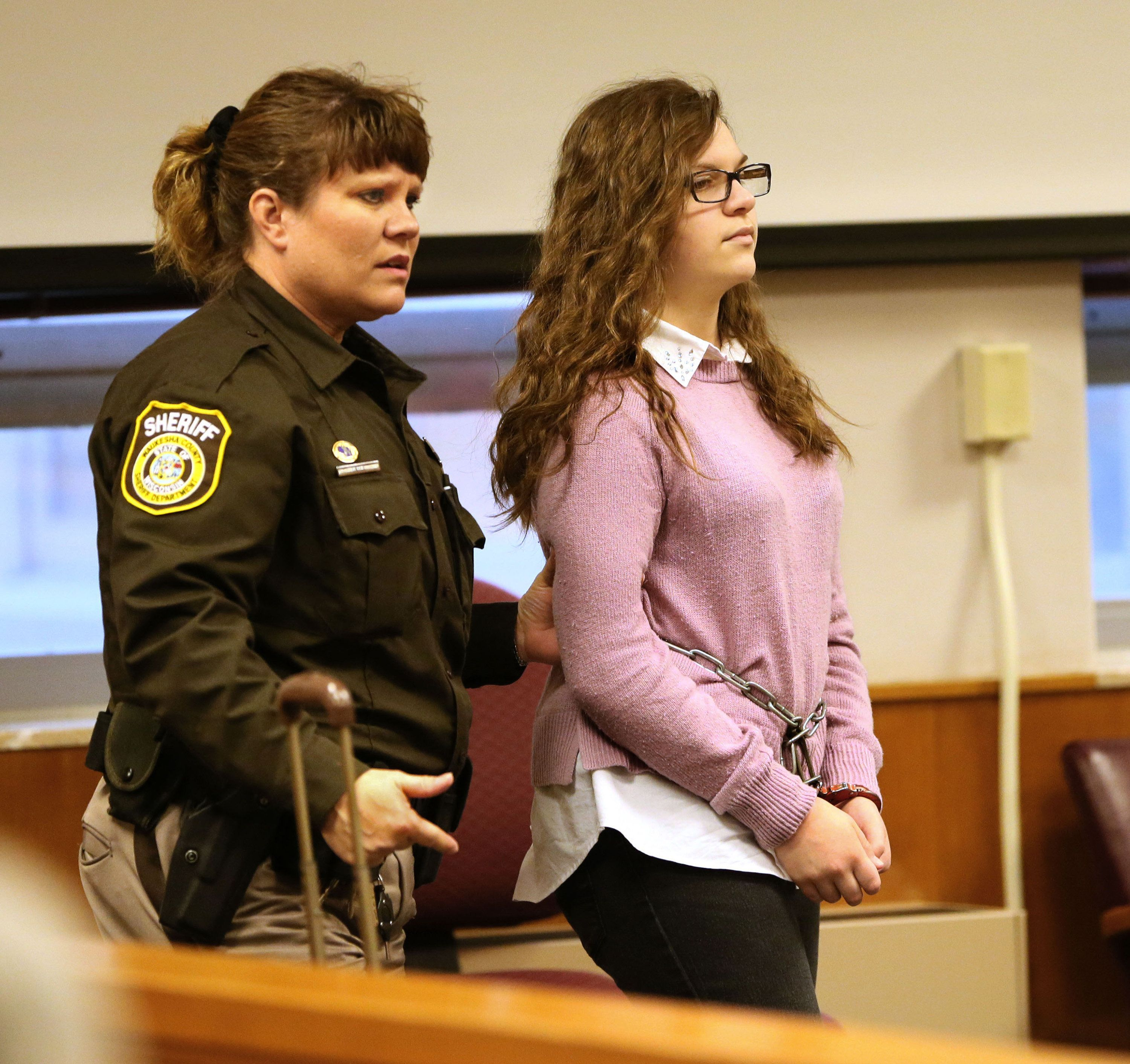 Anissa Weier, accused of being involved in the stabbing of another girl related to the 'Slenderman' online story, is led into the courtroom on Thursday, Dec. 22, 2016 in Waukesha, Wis.  (Michael Sears/Milwaukee Journal Sentinel/TNS via Getty Images)
