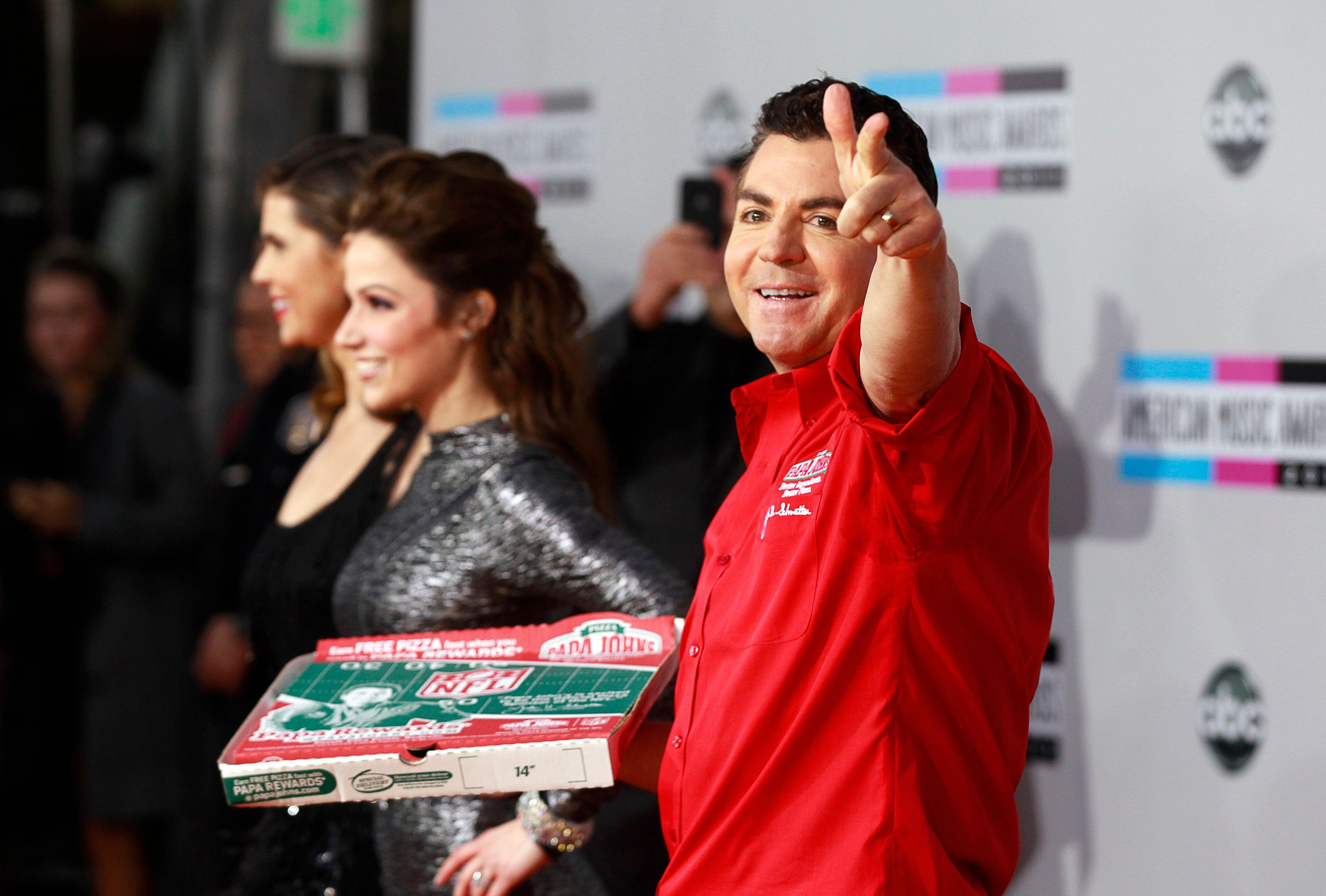 John Schnatter, founder and chief executive of Papa John's Pizza, waves goodbye.