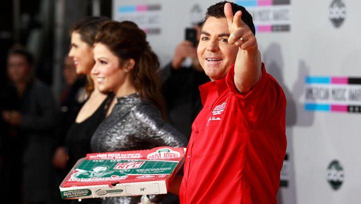 John Schnatter, founder and chief executive of Papa John's Pizza, waves goodbye.