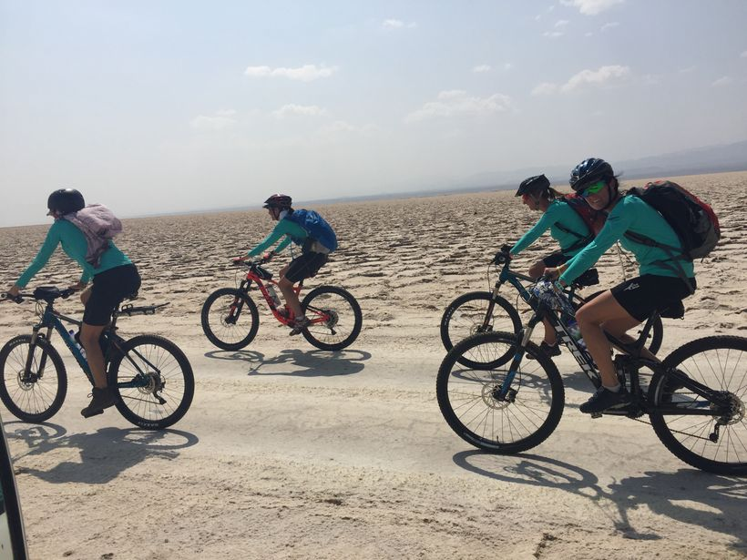 The team cycling across the salt plains on the way to Dallol