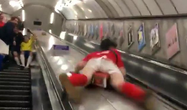 TfL criticises 'dangerous' stunt by darts fan filmed sliding down Tube escalators