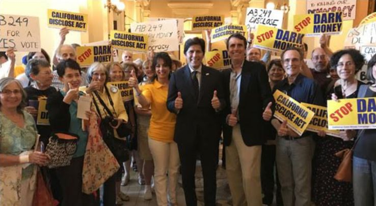 Trent Lange with California Senate President pro Tem Kevin de León and Clean Money supporters after crucial hearing for <em>C
