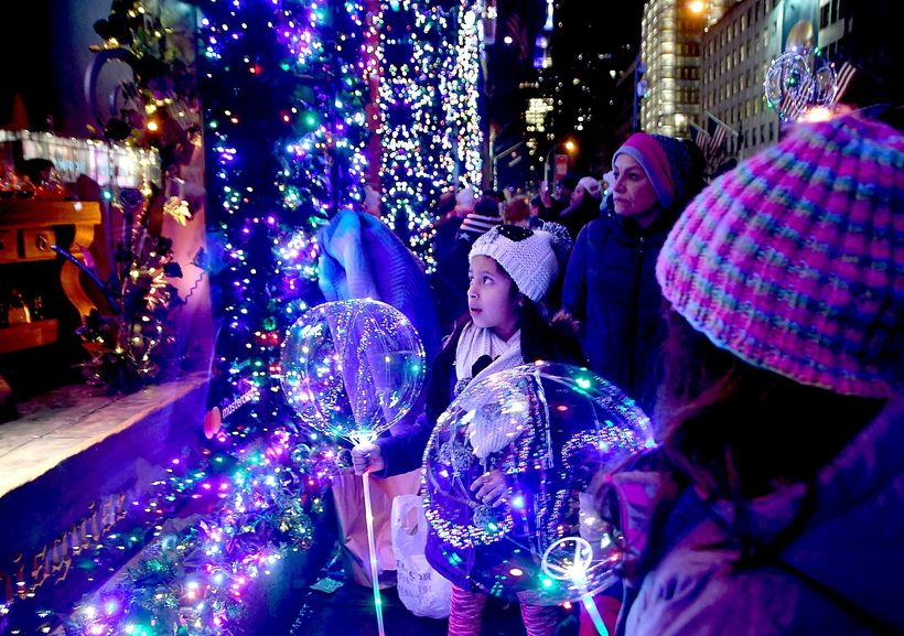 <em>The look of enchantment on a child's face at seeing the animated holiday windows at Saks 5th Avenue.</em>