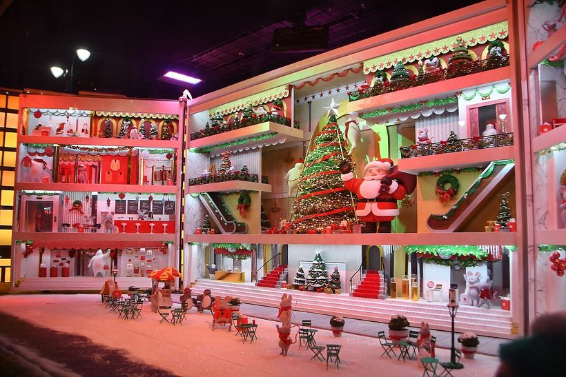 <em>Doors open to reveal what's inside the elaborate dollhouse at Macy's.</em>