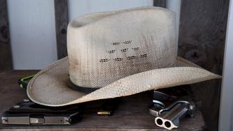 SUTHERLAND SPRINGS, TX - NOVEMBER 6: Two of Kevin Langdon's guns sit under his hat at his home in Sutherland Springs, Texas on November 6, 2017. He knew several of the people killed in the Sutherland Springs First Baptist Church shooting that killed 26 people.   (Photo by Carolyn Van Houten/The Washington Post via Getty Images)