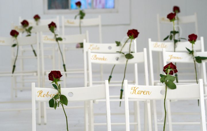 Chairs and roses show where people were found dead at the First Baptist Church of Sutherland Springs.