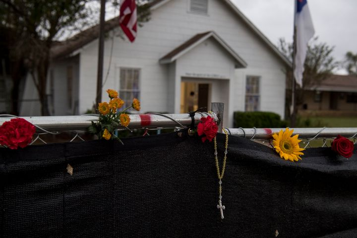 A rosary hangs on the fence surrounding First Baptist Church one week after 26 people were killed in Sutherland Springs, Texa