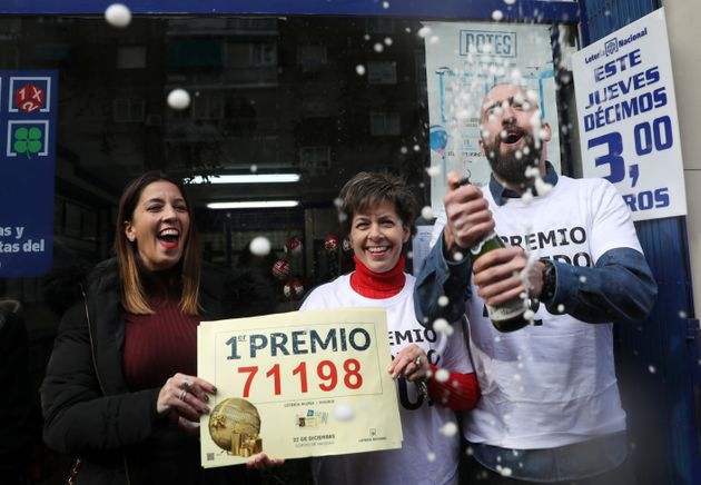 Olivia Muina and her son and daughter, Elena and Javier Castroverde, owners of one of the lottery kiosks...