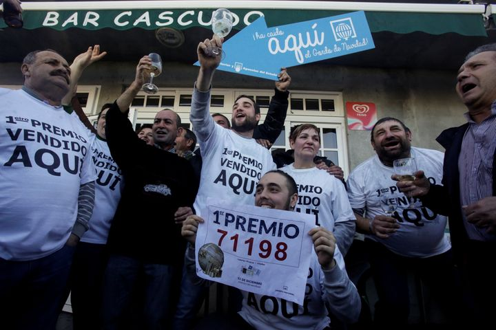 People who bought winning tickets in Spain's Christmas Lottery celebrate in Vilalba on Friday.