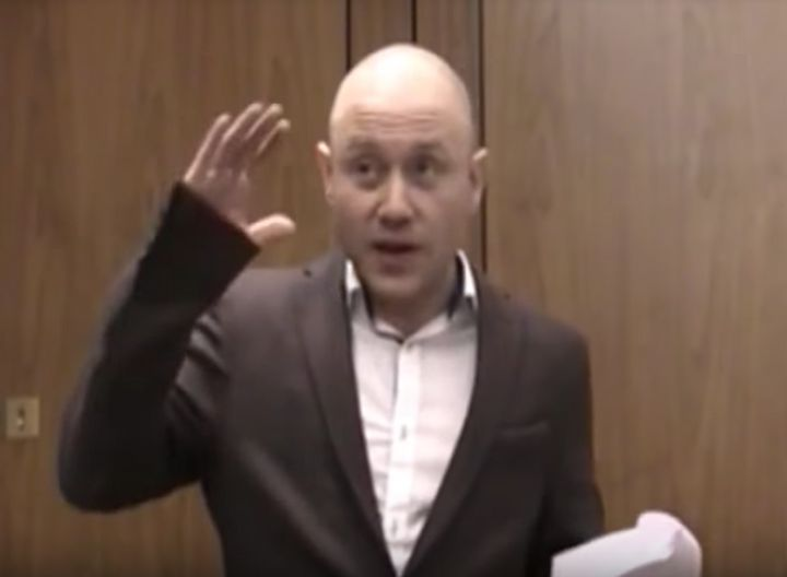 Andrew Anglin, wearing an oversized sport coat, delivers a racist, anti-Semitic speech in London in April 2014.