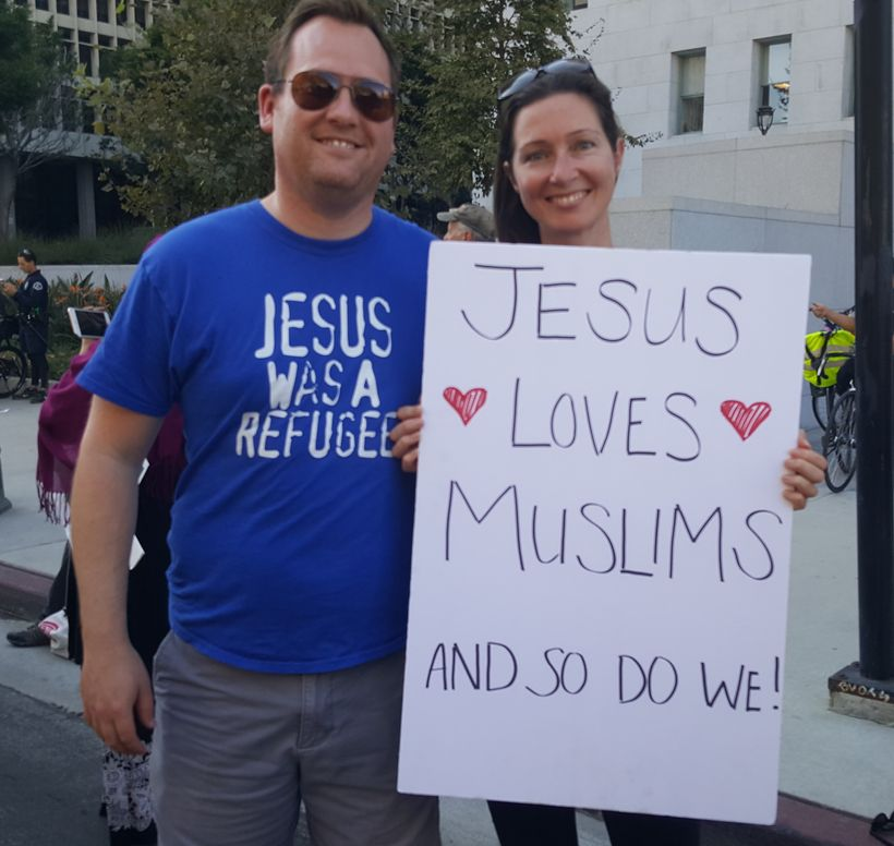 A Christian couple expresses solidarity with Muslims at a recent #NoMuslimBanEver rally in Los Angeles