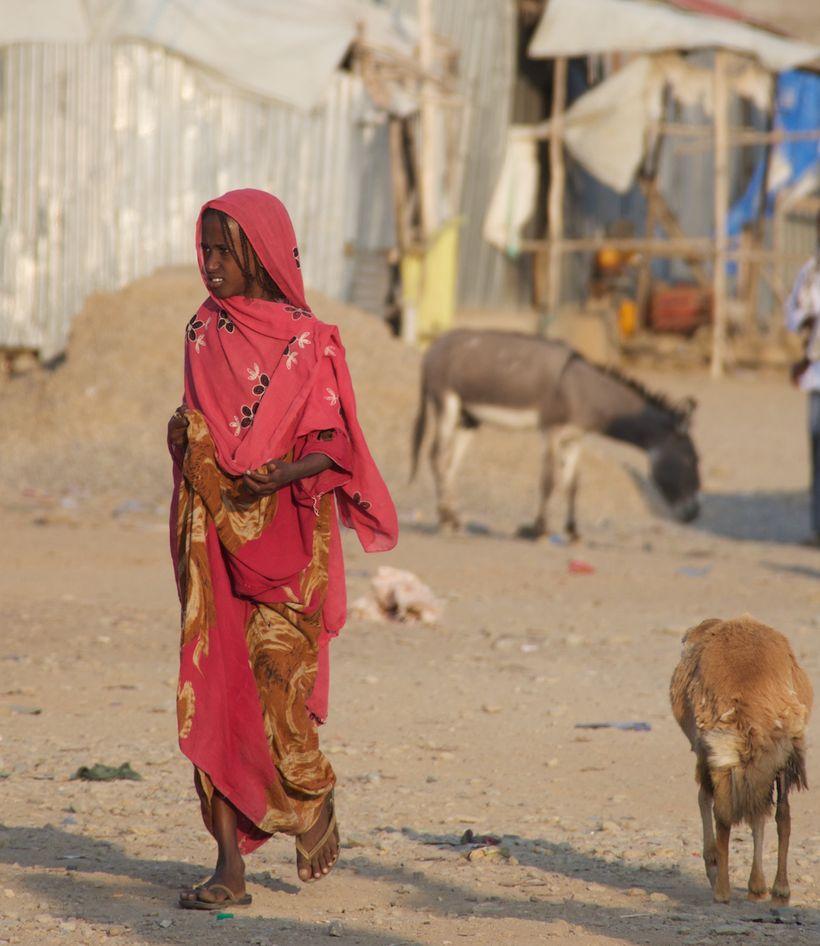 An Afar woman walking through a village in the Danakil
