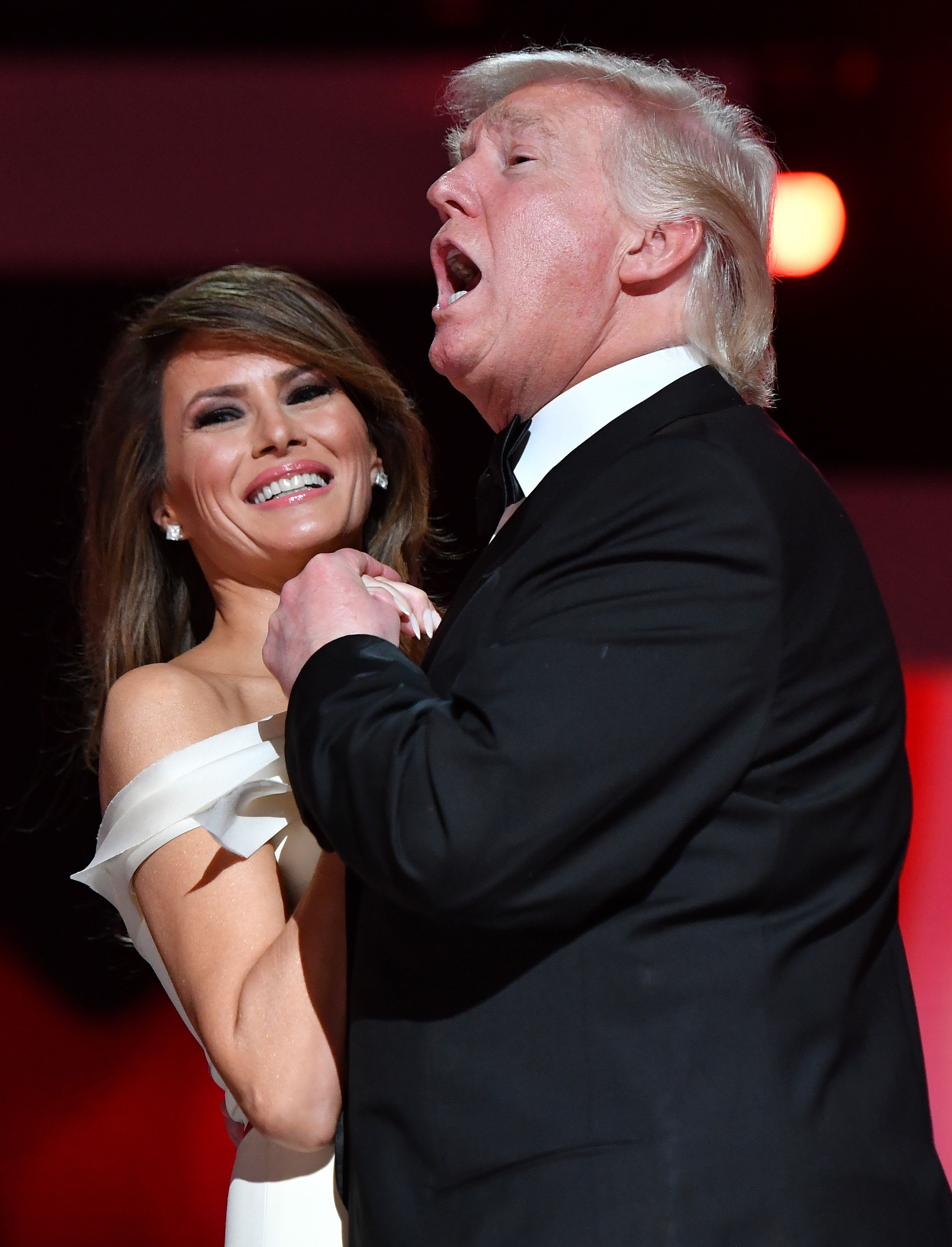 WASHINGTON, DC - JANUARY 20: President Donald Trump singing along to 'My Way' dances with first lady Melania Trump while attending the Freedom Inaugural Ball at the Walter E. Washington Convention Center on January 20, 2017 in Washington, D.C.  Trump will attend three inaugural balls.   (Photo by Kevin Dietsch - Pool/Getty Images)