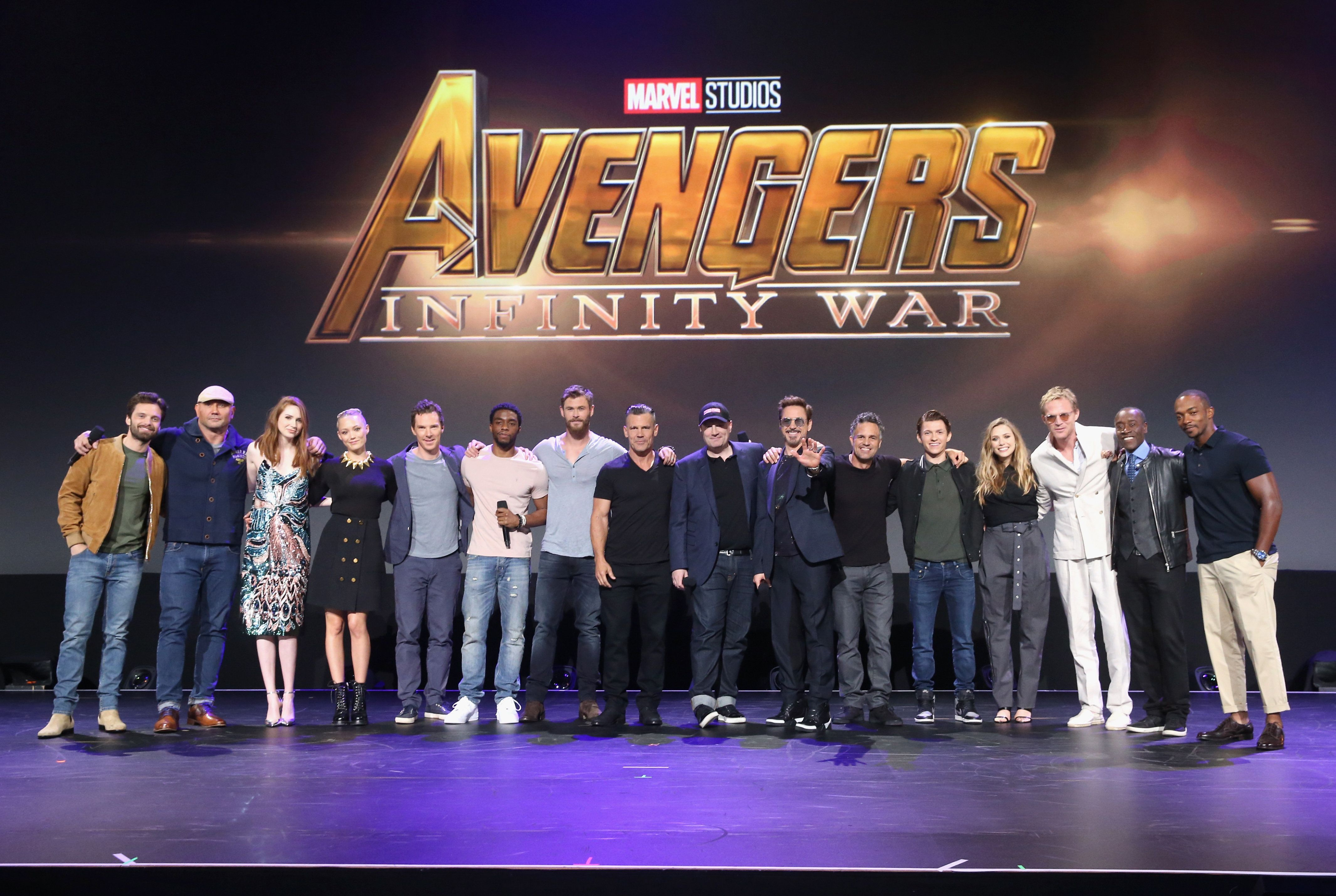 ANAHEIM, CA - JULY 15:  (L-R) Actors Sebastian Stan, Dave Bautista, Karen Gillan, Pom Klementieff, Benedict Cumberbatch, Chadwick Boseman, Josh Brolin, and Chris Hemsworth, producer Kevin Feige, and actors Robert Downey Jr., Mark Ruffalo, Tom Holland, Elizabeth Olsen, Paul Bettany, Don Cheadle, and Anthony Mackie of AVENGERS: INFINITY WAR took part today in the Walt Disney Studios live action presentation at Disney's D23 EXPO 2017 in Anaheim, Calif. AVENGERS: INFINITY WAR will be released in U.S. theaters on May 4, 2018.  (Photo by Jesse Grant/Getty Images for Disney)