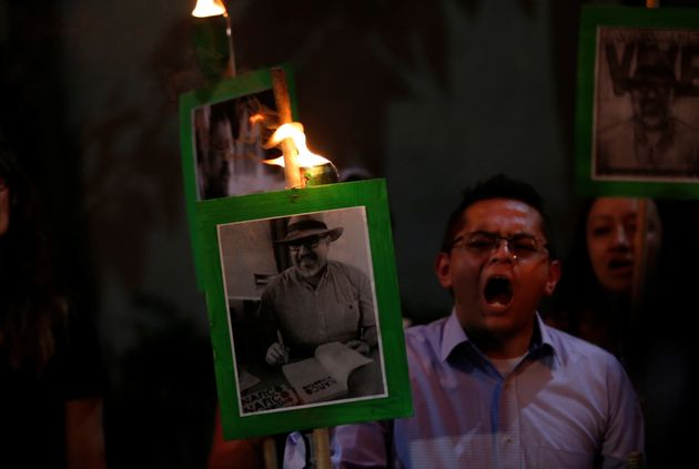 Demonstrators in Mexico City earlier this year held up pictures of journalist Javier Valdez Cardenas...