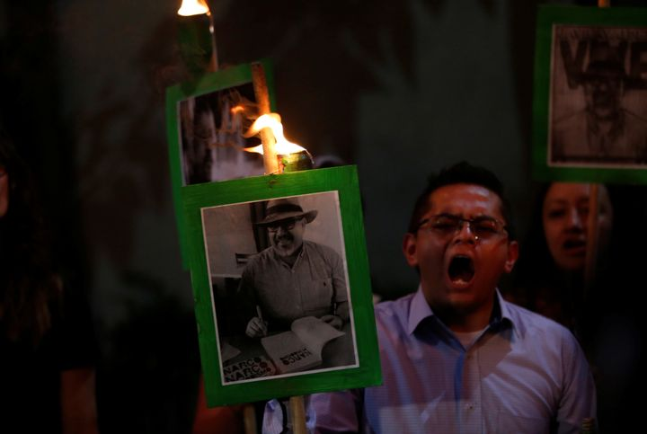 Demonstrators in Mexico City earlier this year held up pictures of journalist Javier Valdez Cardenas to call attention to his