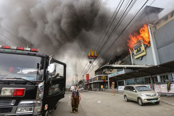 A firefighter stands in front of the NCCC Mall in Davao on the southern Philippine island of Mindanao.